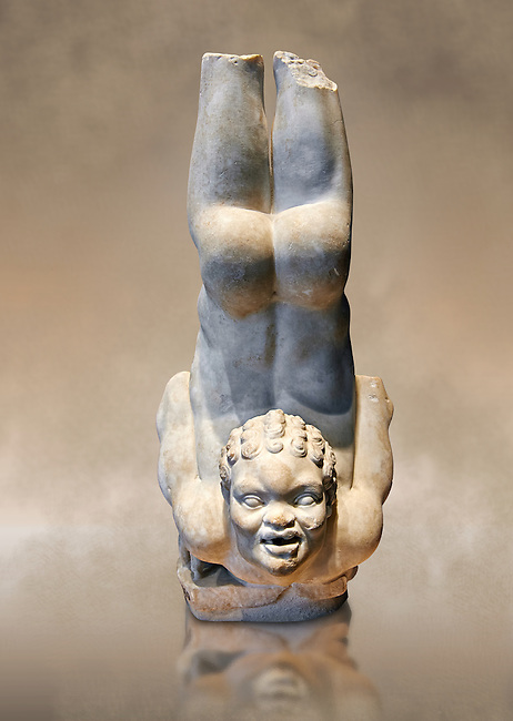 Roman statue of an African Acrobat from early Imperial period excavated from the Villa Patrizi, via Nomentana, Rome, Italy. A young African performs an acrobatic trick very similar to those performed by tribal members from an area of the Nile, the Tentyitae (described by Pliny in Naturalis Historia), where skilled divers dive into the water from the backs of crocodiles. The work is based on a hellenistic original and here has beed adapted for the Roman period as a fountain decoration. The hole in the acrobats mouth is a water spout.  Inv 40009, The National Roman Museum, Rome, Italy  The National Roman Museum, Rome, Italy