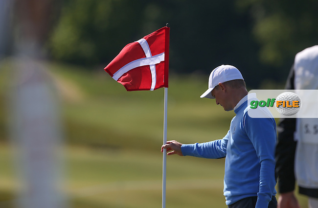 It's Denmark Day; Lasse Jensen (DEN) straightens the pin during Round Two of the 2015 Nordea Masters at the PGA Sweden National, Bara, Malmo, Sweden. 05/06/2015. Picture David Lloyd | www.golffile.ie