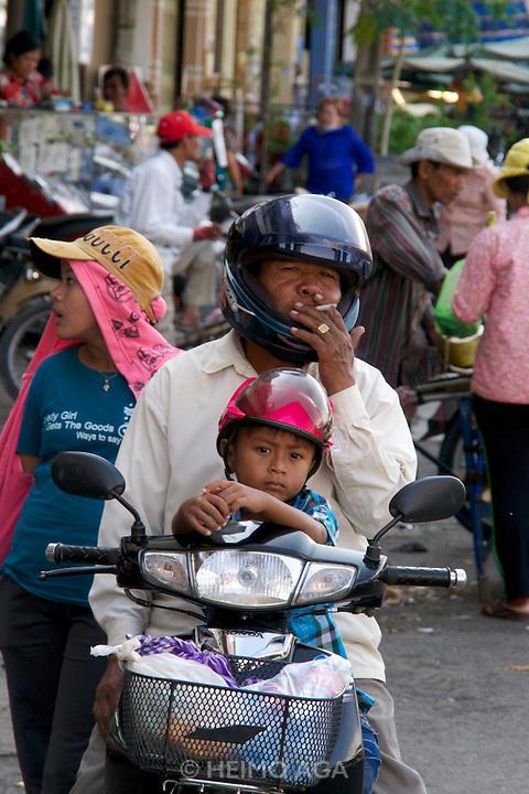 Phnom Penh, Cambodia. Family on a moped.