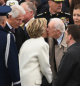 Former President Jimmy Carter kisses Hillary Clinton on the cheek as she and former President Bill Clinton arrive for the Inauguration Ceremony of President Donald Trump on the West Front of the U.S. Capitol on January 20, 2017 in Washington, D.C.  Trump became the 45th President of the United States.      <br /> Credit: Pat Benic / Pool via CNP