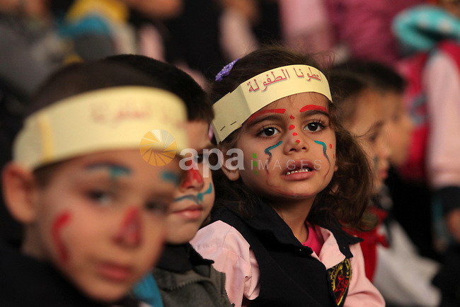 Palestinian children play during an entertaining day to mark the UN Universal Children's Day in Gaza City on November 23, 2016. Photo by Ashraf Amra
