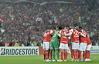 BOGOTÁ-COLOMBIA-03-04-2014. Jugadores de Santa Fe oran previo al partido de vuelta entre Independiente Santa Fe de Colombia y Atlético Mineiro de Brasil, por la primera fase llave G4, de la Copa Bridgestone Libertadores en el estadio Nemesio Camacho El Campin, de la ciudad de Bogota. / Players of Santa Fe pray prior a second leg match between Independiente Santa Fe of Colombia and Atletico Mineiro of Brazil for the first phase, G4 key, of the Copa Bridgestone Libertadores in the Nemesio Camacho El Campin in Bogota city.  Photo: VizzorImage/ Gabriel Aponte /Staff