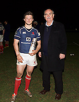 George Horne of London Scottish Football Club is presented with the Man of The Match award after the Greene King IPA Championship match between London Scottish Football Club and Ealing Trailfinders at Richmond Athletic Ground, Richmond, United Kingdom on 26 December 2015. Photo by Alan  Stanford / PRiME Media Images