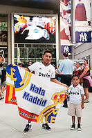Real Madrid fans pose for a photo in Yankee Stadium prior a 2012 Herbalife World Football Challenge match against A. C. Milan at Yankee Stadium in New York, NY, on August 8, 2012.