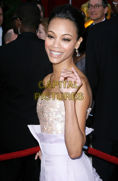 ZOE SALDANA.The 82nd Annual Academy Awards held aat The Kodak Theatre in Hollywood, California, USA..March 7th, 2010 .oscars half length purple gold sequined sequins jewelled bodice strapless top silk chiffon ombre skirt waist lilac hand waving peach ruffles ruffled .CAP/EAST.©Eastman/Capital Pictures.