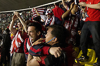 USA fans cheer after the USA tied Mexico in a World Cup Qualifier at Azteca stadium in Mexico City, Mexico on March 26, 2013.