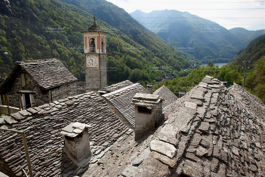 Switzerland. Canton Ticino. Corippo lies in the Verzasca valley. The stone houses are built from the local Ticino granite with stones roofs and have changed little for several hundred years. With a population of just 16, Corippo is the smallest municipality in Switzerland. Despite this, it possesses the trappings of communities many times its size such as its own coat of arms and a town council consisting of three local citizens. A town council is a democratically elected form of government for small municipalities. A council may serve as both the representative and executive branch. The village has maintained its status as an independent entity since its incorporation in 1822. 9.05.13 © 2013 Didier Ruef
