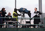 Lindsay Herron of Rangers TV struggling in the weather with his brolly going inside out
