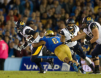Brendon Bigelow of California runs the ball during the game against UCLA at Rose Bowl in Pasadena, California on October 12th, 2013.   UCLA defeated California, 37-10.