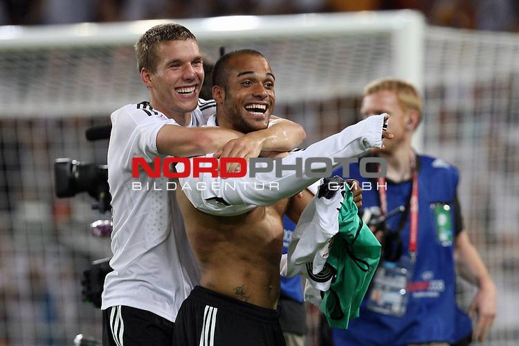 UEFA Euro 2008 Semi-Finals Match 29 Basel - St. Jakob-Park. Deutschland ( GER ) - T&uuml;rkei ( TUR ) 3:2 ( 1:1 ). <br /> Lukas Podolski ( Germany / Angreifer / Forward / Bayern Muenchen #20 ) (l) und David Okondor ( Germany / Angreifer / Forward / Betis Sevilla #19 ) feiern den Sieg gegen die T&uuml;rkei und den Einzug ins Finale.<br /> Foto &copy; nph (  nordphoto  )
