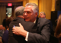 Virginia Governor Terry McAuliffe, right, greets Senator Tim Kaine, left, before a memorial for Heather Heyer Wed., August 16, 2017, at the Paramount Theater in Charlottesville, Va. Heyer was killed the previous weekend when a vehicle drove into a crowd of counter-protestors after the Unite The Right rally. Photo/Andrew Shurtleff