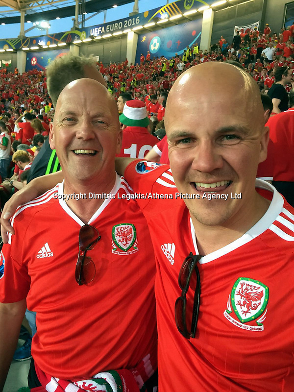 COPY BY TOM BEDFORD MEDIA<br /> Pictured: Matt Evans (R) with his dad Chris (L) in France to watch Wales play against Russia<br /> Re: Former postman, lotto Millionaire Matt Evans, 35, from Barry, south Wales, has been spending his winnings to watch Wales play in the UEFA European Championship in France.
