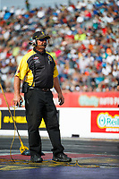 Apr 22, 2017; Baytown, TX, USA; NHRA official starter Mike Gittings during qualifying for the Springnationals at Royal Purple Raceway. Mandatory Credit: Mark J. Rebilas-USA TODAY Sports