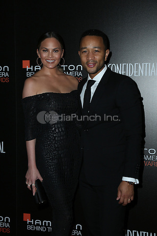 LOS ANGELES, CA - NOVEMBER 06: John Legend, Chrissy Teigen arrive at the 9th Hamilton Behind The Camera Awards at Exchange LA on November 6, 2016 in Los Angeles, California. (Credit: Parisa Afsahi/MediaPunch).