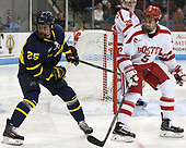 Sami Tavernier (Merrimack - 25), Chad Krys (BU - 5) - The visiting Merrimack College Warriors defeated the Boston University Terriers 4-1 to complete a regular season sweep on Friday, January 27, 2017, at Agganis Arena in Boston, Massachusetts.The visiting Merrimack College Warriors defeated the Boston University Terriers 4-1 to complete a regular season sweep on Friday, January 27, 2017, at Agganis Arena in Boston, Massachusetts.