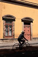 Man riding a bicycle in the city of San Luis de Potosi, Mexico