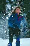 Woman running in snowshoes