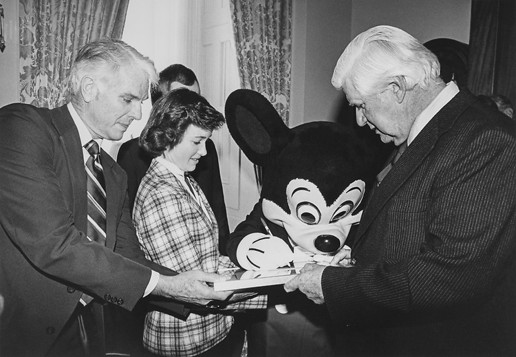 Rep. James F. Lloyd, D-Calif., Nancy Eckardt, Ambassador to the World for Disneyland, with Mickey Mouse and Rep. Tip O'Neill, D-Mass. (Photo by Dev O'Neill/CQ Roll Call)