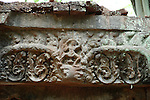 Angkorian temple Prasat Thom at Koh Ker (early 10th century).<br /> Stone door lintel<br /> The Prang or temple tower is the highest ever constructed by the Khmer, rising 36 meters above the forest floor, when consecrated in 921 a 4 metre tall linga was enshrined at its summit. <br /> Koh Ker temple complex is a remote archaeological site in the jungle of Preah Vihear province in northern Cambodia. Inscriptions found at the site say the name of the ancient town was Chok Gargyar. Briefly in the reign of Jayavarman IV and Harshavarman II (928–944 AD) it was the capital of the Khmer Empire.Koh Ker was also known as Lingapura (City of Lingams), all of the monuments here are dedicated to Hindu deities, mainly Shiva.