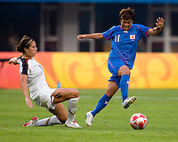 USWNT midfielder (11) Carli Lloyd tackles the ball away from  Japanese midfielder (11) Shinobu Ohno  while playing at Qinhuangdao Stadium. The US defeated Japan, 1-0, during first round play at the 2008 Beijing Olympics in Qinhuangdao, China.