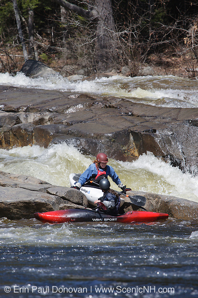 Kayakers at Lower Falls along the Swift River during the spring months in the White Mountains, New Hampshire USA