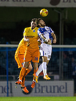 Matty Taylor of Bristol Rovers & Danny Rowe of Wycombe Wanderers go up for the ball during the Sky Bet League 2 rearranged match between Bristol Rovers and Wycombe Wanderers at the Memorial Stadium, Bristol, England on 1 December 2015. Photo by Andy Rowland.
