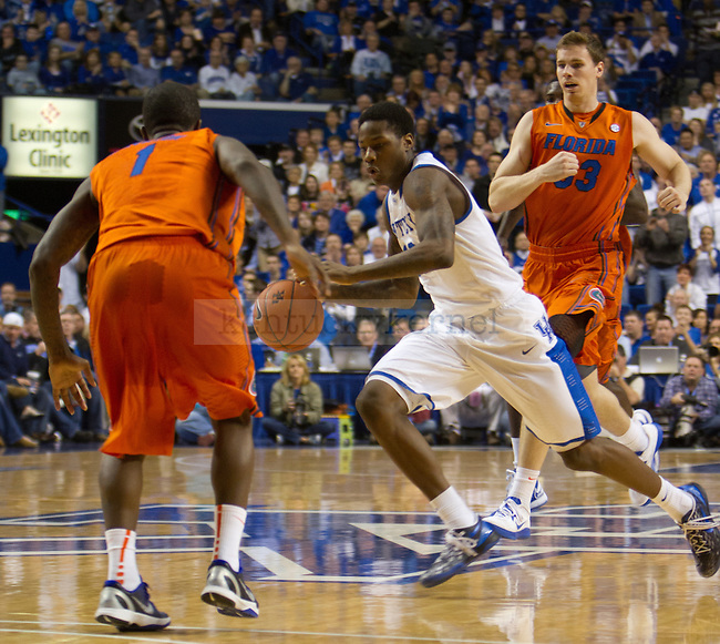 Freshman G Archie Goodwin (10) drives past Senior Florida G Kenny Boynton (1) during the 61-57 UK win vs Florida Men's basketball game in Lexington, Ky., on Saturday, March 9, 2013. Photo by Matt Burns | Staff