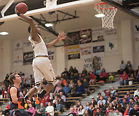 NWA Democrat-Gazette/J.T. WAMPLER  Bentonville's Malik Monk goes up for a dunk Tuesday Jan. 26, 2016 during the Tigers' 60-39 win over Heritage.