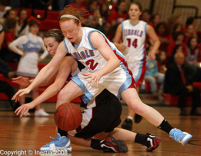SIOUX FALLS, SD - January 9:  Carsey Barden #4 of Sturgis battles for a loose ball with Caiti Slattery #12 from Lincoln in the second half of their game Friday night at Lincoln. (Photo by Dave Eggen/Inertia)
