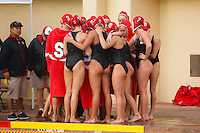 Stanford - February 1, 2015: Team huddles after winning the Stanford vs UCLA title match of the 2015 Stanford Invitational at Avery Aquatic Center on Sunday afternoon.<br /> <br /> The Cardinal defeated the Bruins 9-5.
