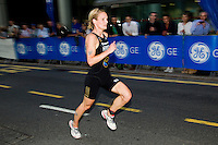 28 JUN 2012 - LONDON, GBR - Katie Hewison leads the run during the elite women's 2012 Canary Wharf Triathlon final in Canary Wharf, London, Great Britain (PHOTO (C) 2012 NIGEL FARROW)