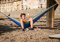 UK Weather: Aberystwyth, Ceredigion, West Wales <br />A man is relaxing in a hammock during the early evening in Aberystwyth beach.