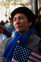 (961193-SWR10.jpg) New York, NY - File Photo -- An Hispanic Women holds a sn American Flag during an Immigrants rally in Battery Park. .Photo © Stacy Walsh Rosenstock