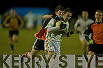 St Kierans silky corner forward Pa McCarthy draws a foul from Duhallow's Michael Casey .