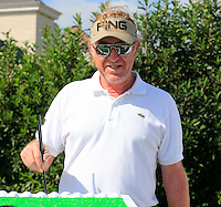 Miguel Angel Jimenez (ESP) tries the chopsticks challenge during Tuesday's Pro-Am Day of the 2014 BMW Masters held at Lake Malaren, Shanghai, China 28th October 2014.<br /> Picture: Eoin Clarke www.golffile.ie