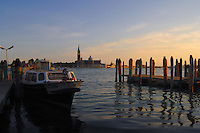Early morning on the Grand Canal in Venice, Italy.Showing San Giorgio Maggiore in the background, with early morning vaporetti waiting at dockside.