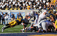 Ohio State Buckeyes running back Jordan Hall (2) scores a touchdown against California Golden Bears cornerback Cameron Walker (14) in the 2nd quarter at Memorial Stadium in Berkeley, California on September 14, 2013.  (Dispatch photo by Kyle Robertson)