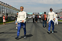 March 26, 2017: Marcus Ericsson (SWE) #9 and Antonio Giovinazzi (ITA) from the Sauber F1 Team walk back to the pits after the drivers' parade at the 2017 Australian Formula One Grand Prix at Albert Park, Melbourne, Australia. Photo Sydney Low