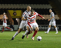 Jon Routledge being challenged by Jim Goodwin in the St Mirren v Hamilton Academical Scottish Communities League Cup match played at St Mirren Park, Paisley on 25.9.12.