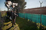 People taking part on the march,  with basque flags and banners asking the repatriation of basque prisoners, get close to the prison's fence. Caceres (Spain). February 20, 2016. Some friends and relatives of Basque political prisoners take part on a march to Caceres penitentiary center, within the campaign of 40 marches to 40 prisons where Basque prisoners are imprisoned. These marches are to denounce the dispersal policy those prisoners suffer since more than 25 years. (Gari Garaialde / Bostok Photo)
