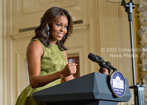 First lady Michelle Obama welcomes military families to a preview of the 2015 White House Christmas decorations in the East Room of the White House in Washington, DC on Wednesday, December 2, 2015.<br /> Credit: Ron Sachs / CNP