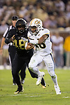 Georgia Tech Yellow Jackets quarterback TaQuon Marshall (16) runs away from the pursuit of Willie Yarbary (48) of the Wake Forest Demon Deacons during first half action at Bobby Dodd Stadium on October 21, 2017 in Atlanta, Georgia.  The Yellow Jackets defeated the Demon Deacons 38-24. (Brian Westerholt/Sports On Film)