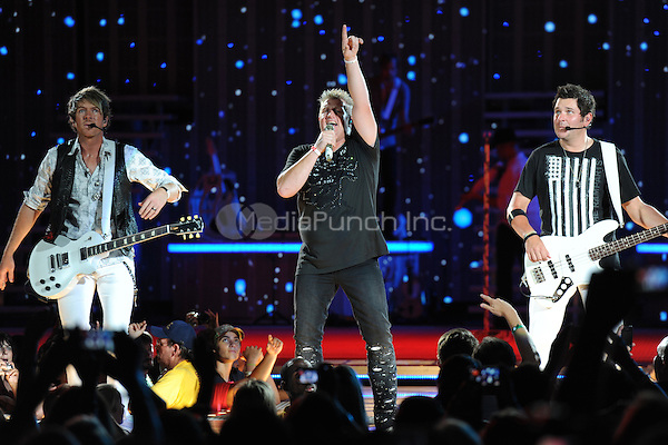 WEST PALM BEACH, FL - AUGUST 21 : Joe Don Rooney, Gary Levox and Jay DeMarcus of Rascal Flatts perform at the Cruzan Amphitheatre on August 21, 2011 in West Palm Beach Florida. © MPI04 / Media Punch Inc.