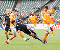 San Francisco, California - Saturday March 17, 2012: Geoff Cameron and  Bobby Boswell defending Chris Wondolowski during the MLS match at AT&T Park. Houston Dynamo defeated San Jose Earthquakes  1-0