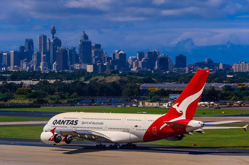 A Quantas Airbus Boeing 747 jet taxiing on the runway at Sydney Airport, Sydney, New South Wales, Australia