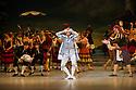 London, UK. 30.03.2013. The Mikhailovsky Ballet present DON QUIXOTE at the London Coliseum. Picture shows: Pavel Maslennikov (Gameche) and Philip Parkhachov (Lorenzo). © Jane Hobson.