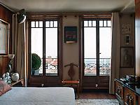 On the wall between the bedroom windows is a work by Erol Akyavas, a modern Turkish painter above an original Hans Wegner chair