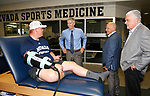 University of Nevada, Reno Athletic Director Doug Knuth, left, Raiders president Marc Badain and Democratic governor candidate Steve Sisolak talk with student athlete Sean Krepsz during a tour of the campus in Reno, Nev., on Thursday, Aug. 16, 2018. The Raiders are considering several potential training camp locations in Reno. (Cathleen Allison/Las Vegas Review-Journal)
