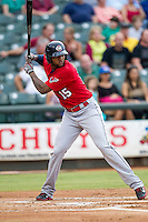 Oklahoma City RedHawks outfielder Domingo Santana (15) at bat during the Pacific Coast League baseball game against the Round Rock Express on August 1, 2014 at the Dell Diamond in Round Rock, Texas. The Express defeated the RedHawks 6-5. (Andrew Woolley/Four Seam Images)