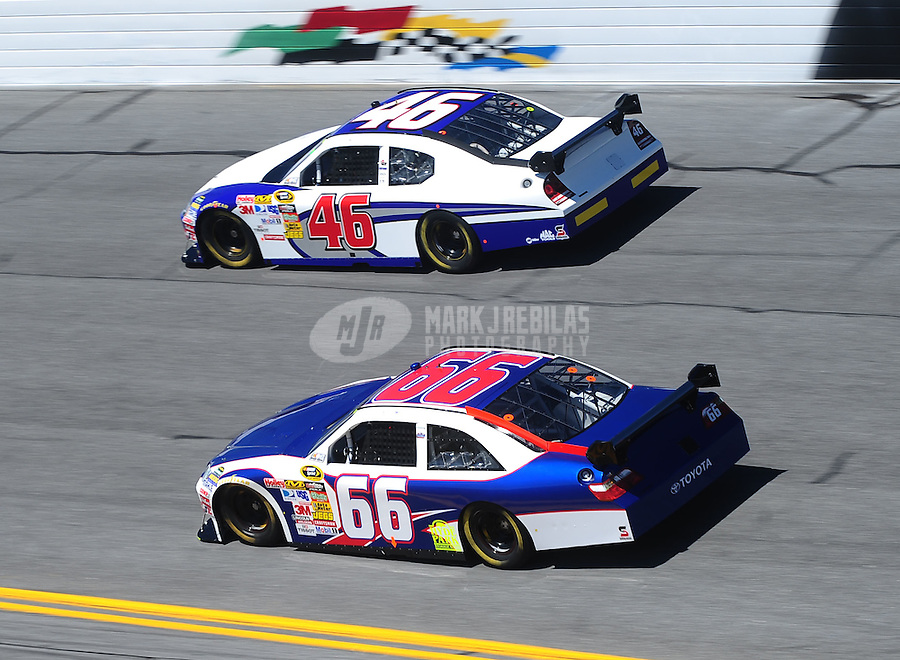Feb 10, 2010; Daytona Beach, FL, USA; NASCAR Sprint Cup Series driver Dave Blaney (66) races alongside Terry Cook (46) during practice for the Daytona 500 at Daytona International Speedway. Mandatory Credit: Mark J. Rebilas-